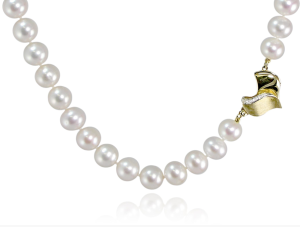 Pearl necklace with gold and diamond clasp.