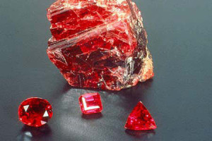 A rough ruby and faceted rubies.