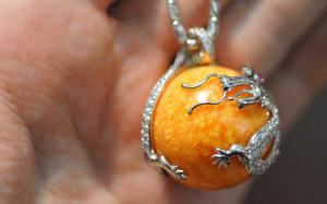A melo melo pearl dragon pendant.