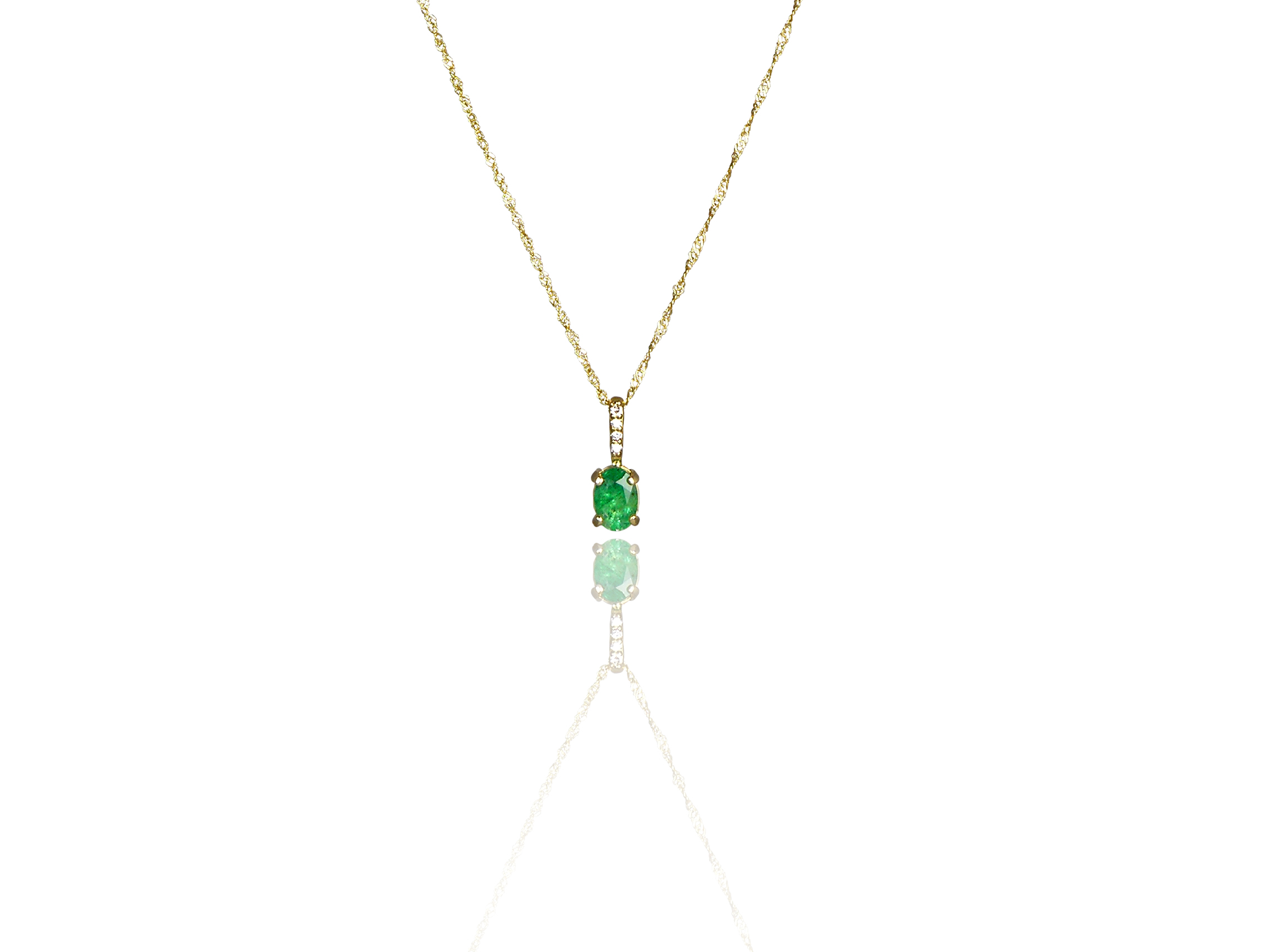 This Stunning Emerald Pendant in 14k Gold from Pearls International would make Cleopatra Green With Envy!
