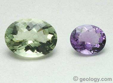 "Prasiolite, sometimes called :green amethyst"" next to true amethyst."